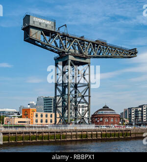 The famous Finnieston Crane at Finnieston Quay on the River Clyde in Glasgow Scotland UK with the Rotunda right - Stock Image