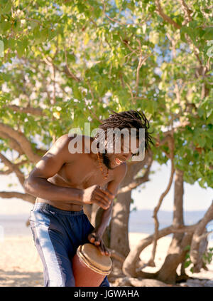 Reggae artist Coolant finds a beat on Lime Cay Island. Kingston, Jamaica, Eastern Caribbean. - Stock Image
