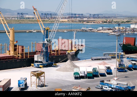 Trucks, Cranes and Ships loading salt,  Cagliari Harbour, Sardinia, Europe, truck lorry wait waiting at Cagliari Port, truck l - Stock Image