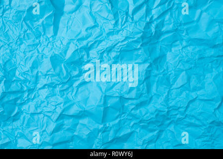 blue crumpled paper texture as background. concept of school, abstract and stress - Stock Image