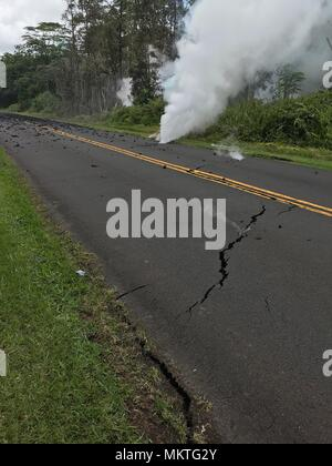Steam vents from cracks caused by the 6.9 magnitude earthquake from the Kilauea volcanic eruption along Leilani Street May 4, 2018 in Leilani Estates, Hawaii. The recent eruption continues destroying homes, forcing evacuations and spewing lava and poison gas on the Big Island of Hawaii. - Stock Image