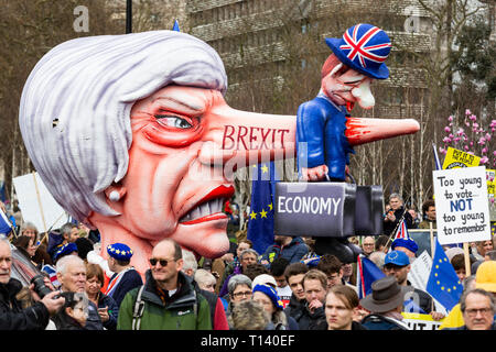 London, UK. 23rd Mar, 2019. Jacques Tilly's Brexit float with a Theresa May effigy. Remain supporters and protesters take part in a march to stop Brexit in Central London calling for a People's Vote. Credit: Vibrant Pictures/Alamy Live News - Stock Image