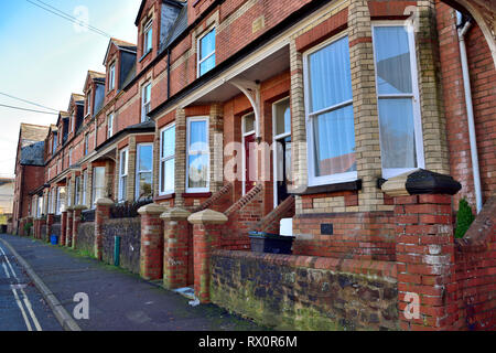 Row of Edwardian three story terraced houses in Tiverton, Devon with dormer windows - Stock Image