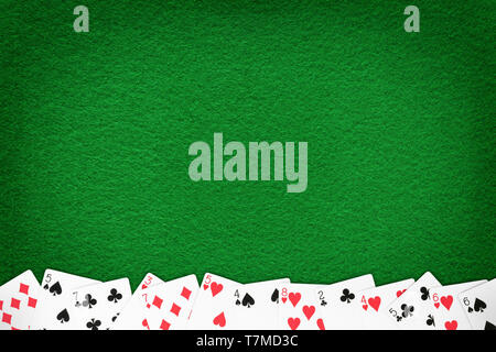 Green casino felt table with cards row. Gambling theme template and background - Stock Image