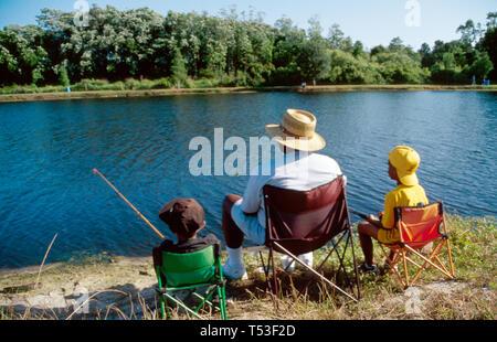 Florida Polk County Auburndale Fairgrounds Park Lake Kid's All American Fishing Derby Black family - Stock Image