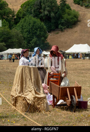 Duncan Mills, CA - July 14, 2018: Reenactor women in costumes at the Civil war reenactment. The Civil War Days is one of the largest reenactment event - Stock Image