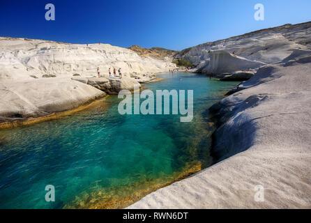 Clear waters of Sarakiniko bay, Milos island, Cyclades, Greece - Stock Image