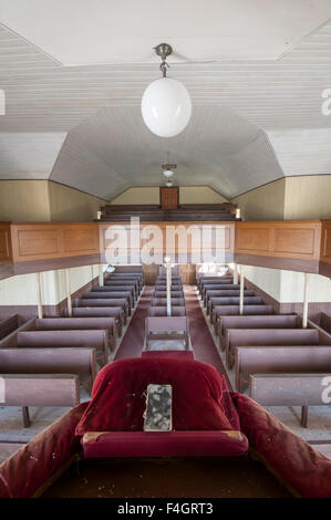 Interior view from the pulpit of an abandoned Free Church of Scotland church - Stock Image