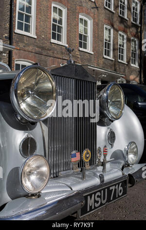 A 1954 Rolls-Royce Silver Dawn is parked in Smith Square, a small square behind the Houses of Parliament, before collecting its VIP passengers - barristers who are being sworn in as QCs (aka Silks in legal vernacular), on 11th March 2019, in London, England. - Stock Image