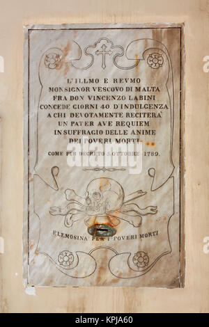 Roman Catholic history. Plaque in Valletta, Malta, promising 40 days of indulgence to those who recite prayers for - Stock Image
