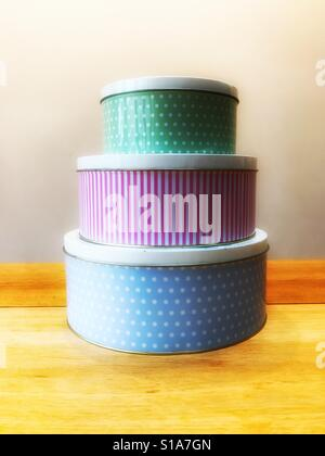 A stack of cake tins - Stock Image