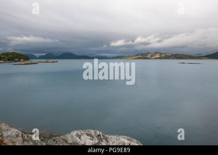 Nordic landscape with rocky coast line during an overcast day. - Stock Image