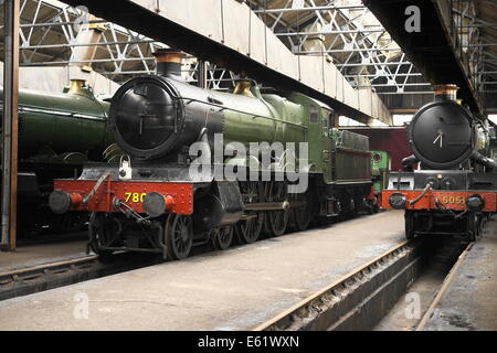 Steam engines in a preserved locomotive maintenance shed at Didcot railway centre - Stock Image