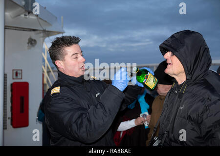 Hotel Manager, Per Oyvind Dahl dispensing cod liver oil whilst crossing the arctic circle southwards on the Hurtigruten, MS Polarlys. - Stock Image