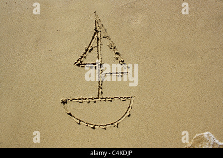 Drawing of a sail boat wet sand. Please see my collection for more similar photos. - Stock Image