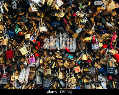 Close-up shot of love locks fastened to each other - Stock Image