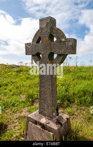old cross-shaped gravestone in an abandoned coastal cemetery - Stock Image