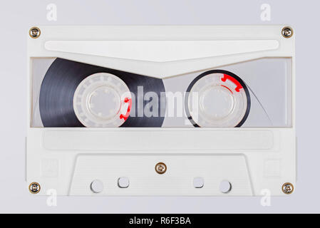 Retro white transparent audio tape isolated on white background - Stock Image