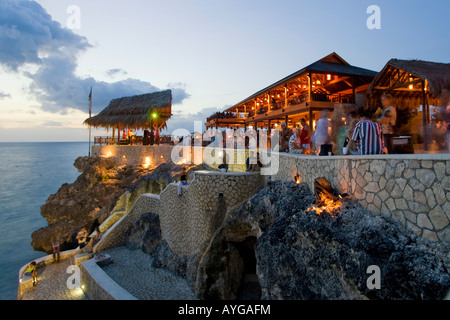 Jamaica Negril Ricks Cafe open air bar viewpoint at sunset - Stock Image