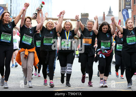 Lisa Roussos, mum of eight-year-old Saffie, the youngest victim of the Manchester bombing (centre) completes the Simply Health Manchester Run. - Stock Image