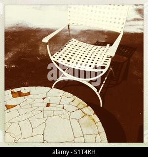 Vintage table and chair white - Stock Image