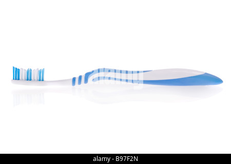 Blue toothbrush isolated on a white background - Stock Image