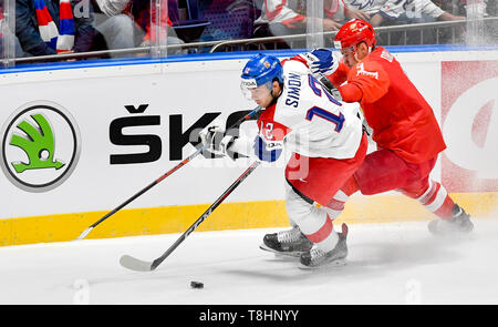 Bratislava, Slovakia. 13th May, 2019. From left Czech ice hockey player DOMINIK SIMON and DMITRIJ ORLOV of Russia in action during the match Czech Republic against Russia at the 2019 IIHF World Championship in Bratislava, Slovakia, on May 13, 2019. Credit: Vit Simanek/CTK Photo/Alamy Live News - Stock Image