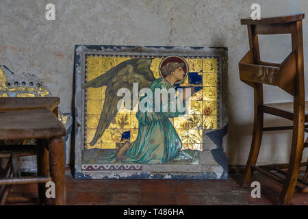 Tiled image depicting a praying angel on its knees inside the St Nicholas' Church, Freefolk, Hampshire, England, UK - Stock Image