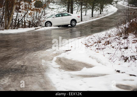 automobile slid off icy winding road - Stock Image