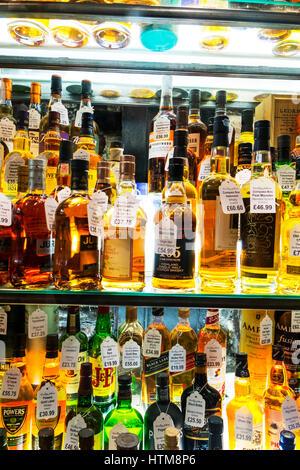 Malt whisky shop display single malt whisky bottle whisky bottles rare whisky bottles expensive whisky bottles - Stock Image