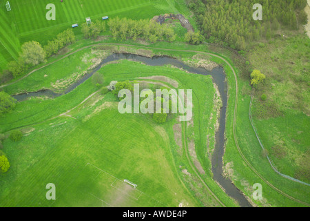 Aerial view of a bend in a river as it winds through the countryside - Stock Image