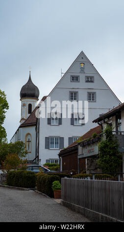 Hohenpeißenberg, Germany- May 19, 2019. Back view of the Pilgrimage Church of the Assumption, from the street. This recently renovated church is a tou - Stock Image