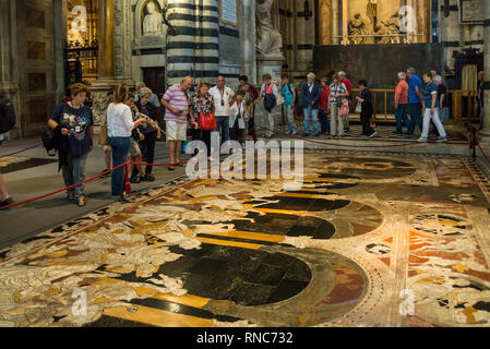 Tourists inside of Duomo di Siena (Siena Cathedral), Tuscany, Italy - Stock Image