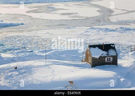Tiniteqilaq and sea ice in winter, E. Greenland - Stock Image