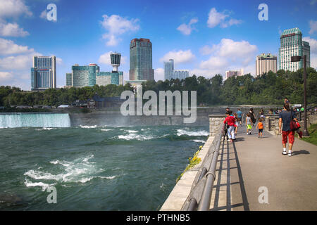 Niagara Falls, USA – August 29, 2018: Tourists view the Niagara Falls the Canadian side with famous hotels across from the American side, New York Sta - Stock Image