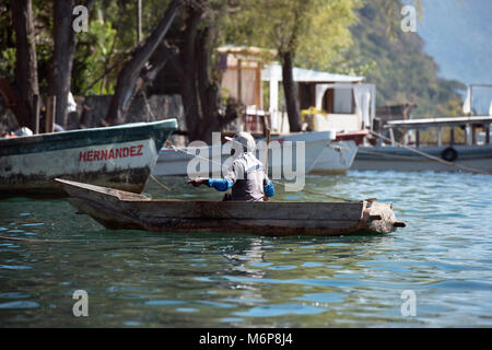 An indigenous, ethnic Mayan man making his living from fishing. Lake Atitlán, Sololá Department, Guatemala. - Stock Image