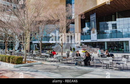 CHARLOTTE, NC, USA-1/8/19: The veranda in front of the Mint Museum in uptown attracts social life on a warm, sunny January day. - Stock Image