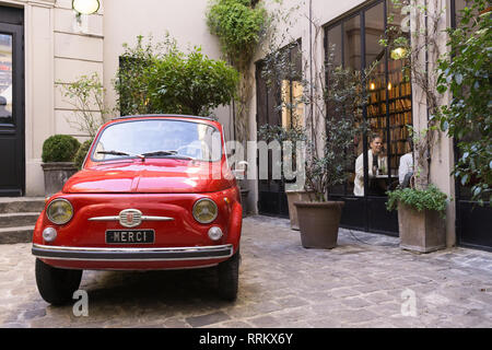 Red Fiat 550 in front of the Merci concept store in Paris, France. - Stock Image