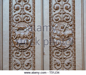 Architectural details of the main Catholic church wooden door. The colonial building is a famous place and a tourist attraction - Stock Image