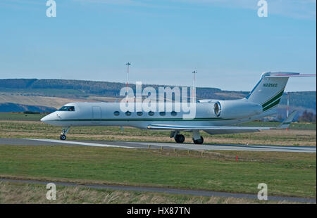 Large Business Jet Gulfstream GV aArriving at Inverness Dalcross airport in the Scottish Highlands. - Stock Image