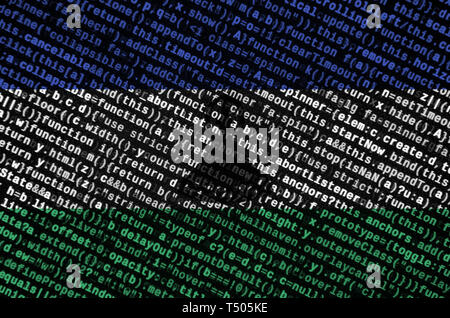 Lesotho flag  is depicted on the screen with the program code. The concept of modern technology and site development. - Stock Image