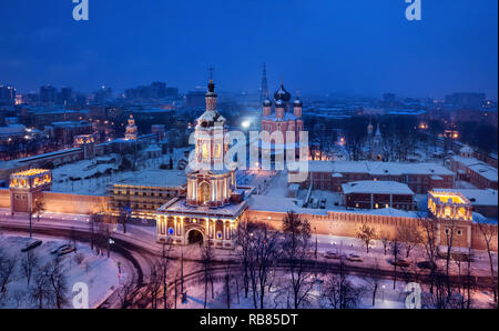 Aerial view of Donskoy Monastery with gate tower on foreground at dusk, Moscow, Russia - Stock Image
