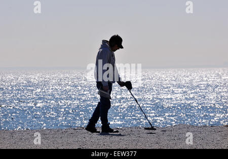 Milford CT USA-- Bill Plantamura enjoys the mild winter weather as he uses his new 'toy,' a metal detector, - Stock Image