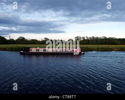 Narrow boat on the Thames going into Abingdon, Oxfordshire. Evening light with stormy sky. (set of 16 ) - Stock Image
