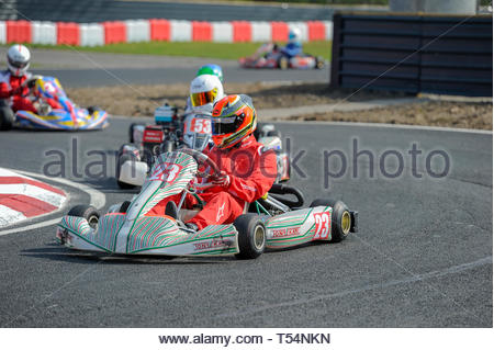 Larkhall, UK. 21st April, 2019. Action at the Hairpin in a Junior Max/Mini Max heat during Round 2 of the 2019 WSKC Club Championship at Summerlee Raceway. Credit: Roger Gaisford/Alamy Live News - Stock Image