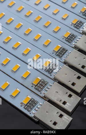 Macro photo of cheap Chinese USB-powered LED lights - energy efficient illumination used for camping, laptop use, emergency light source, etc. - Stock Image