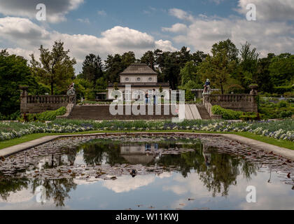 Munich, Bavaria, Germany - May 23, 2019.  München-Nymphenburg Botanical garden on a spring day featuring the entrance and the cafe, viewed from the ba - Stock Image