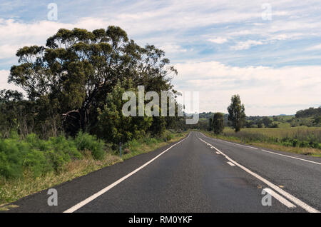 A view along an empty road outside Sydney. - Stock Image