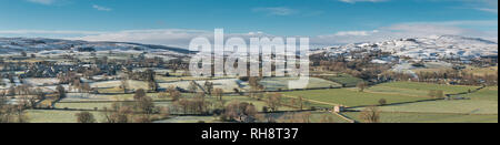 North Pennines AONB panoramic landscape, view from Whistle Crag over Teesdale into Lunedale with snow covered hills in the distance in bright winter s - Stock Image
