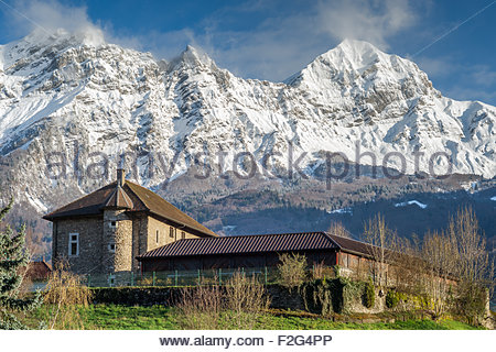 Museum of arts and crafts in Ugine near Albertville (France) and Mount Charvin in the background - Stock Image